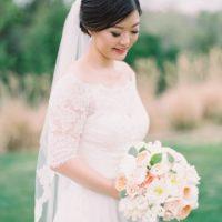 bride looking down at bouquet portrait