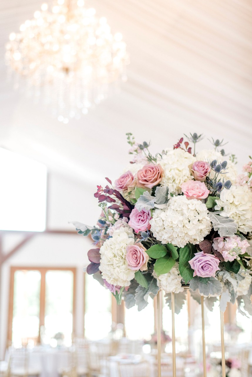 pastel centerpiece and grand chandelier