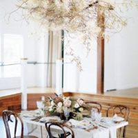 wild organic tablescape with hanging arrangement