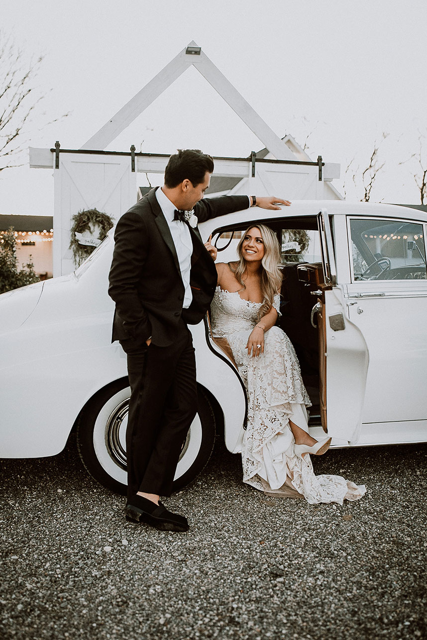 couple getting into getaway car + what to know before hiring a weddng videographer