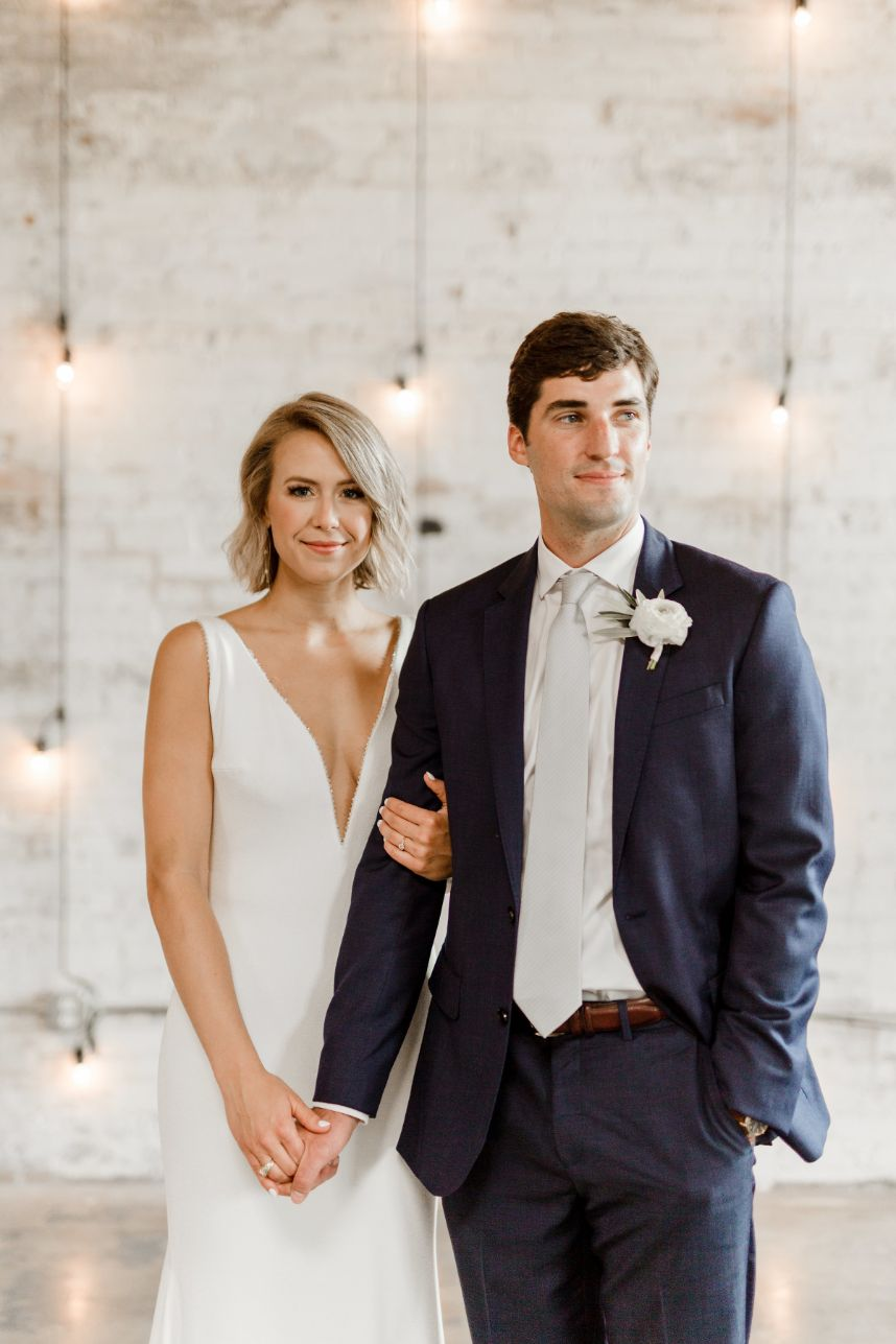 bride and groom standing close together | tips on preparing a shot list for your photographer
